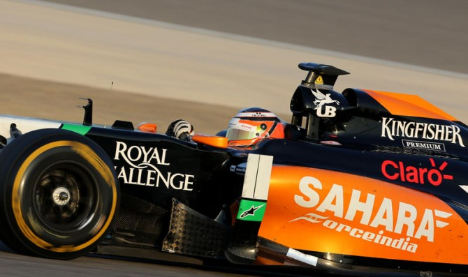 Hulkenberg tops on first day of tests