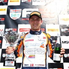 Kjaergaard takes win from pole